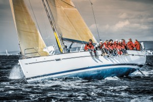 Sailing crew on sailboat on regatta